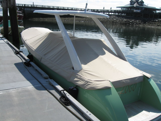 Power boat with full mooring cover
