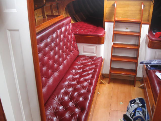 Red leather button bench below deck