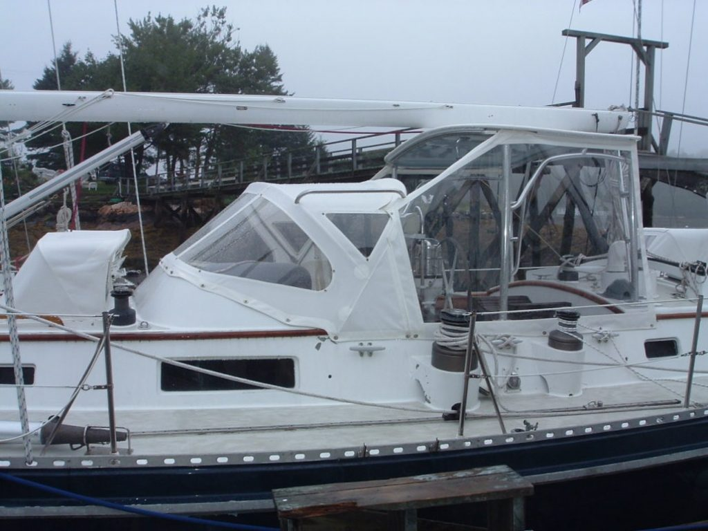 White full dodger, bimini and enclosure on sailboat